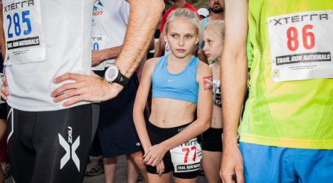 (PHOTO/New York Times) Kaytlynn Welsch, 12, center, and Heather Welsch, 10, before running more than 13 miles on a mountainous Utah course in September.