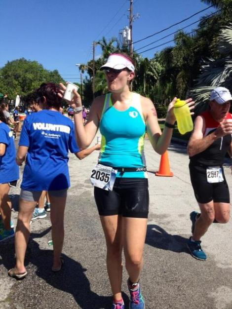 My friend Stephanie of St. Pete Road Runners took this lovely portrait of me at the mile 4 water stop.  Of note: the salt encrusted on my tri shorts.
