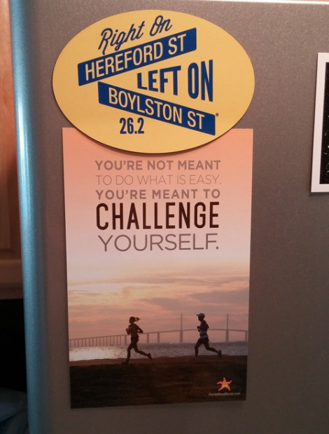 Motivation on my fridge.  The Boston Marathon magnet was a gift from my friend Lindsay, who also got me the rubber bracelet I reference in the post. The postcard was designed the wife of my friend and local race director Chris Lauber.