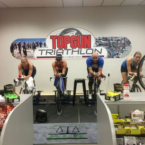 Me getting my ass kicked on the Computrainer by three of my sources of real-life fitspo.  (From left to right: Katie Corbin, Corrie Hacking, Brian and me)
