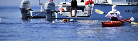 Bonnie Stoll at her Head Handler post, watching as Diana Nyad swims. Image credit: Dawn L. Blomgren, courtesy of Diana Nyad, all rights reserved.